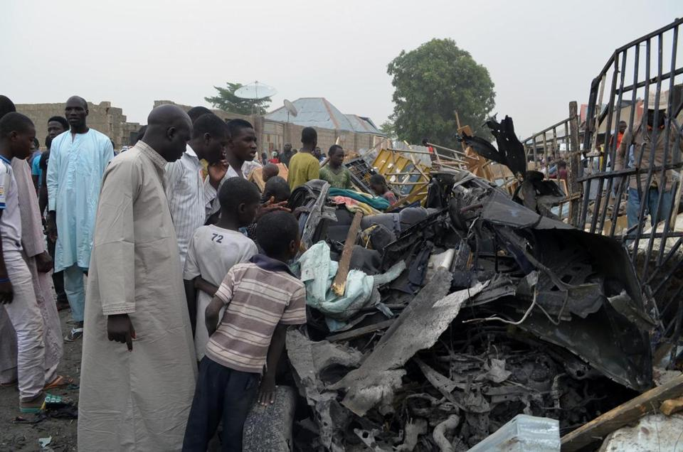 Nigerians examined the rubble Sunday after two car bombs exploded in Maiduguri the previous night.