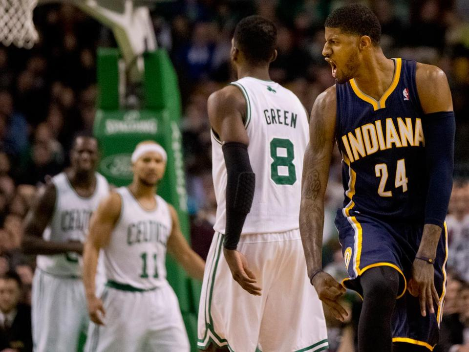 Paul George (right) reacts after hitting a 3-pointer in the fourth that sealed it for Indiana.