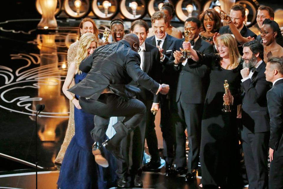 "A leaping director-producer Steve McQueen celebrated with cast members after the historical drama ""12 Years a Slave"" was named best picture at the Academy Awards Sunday night."