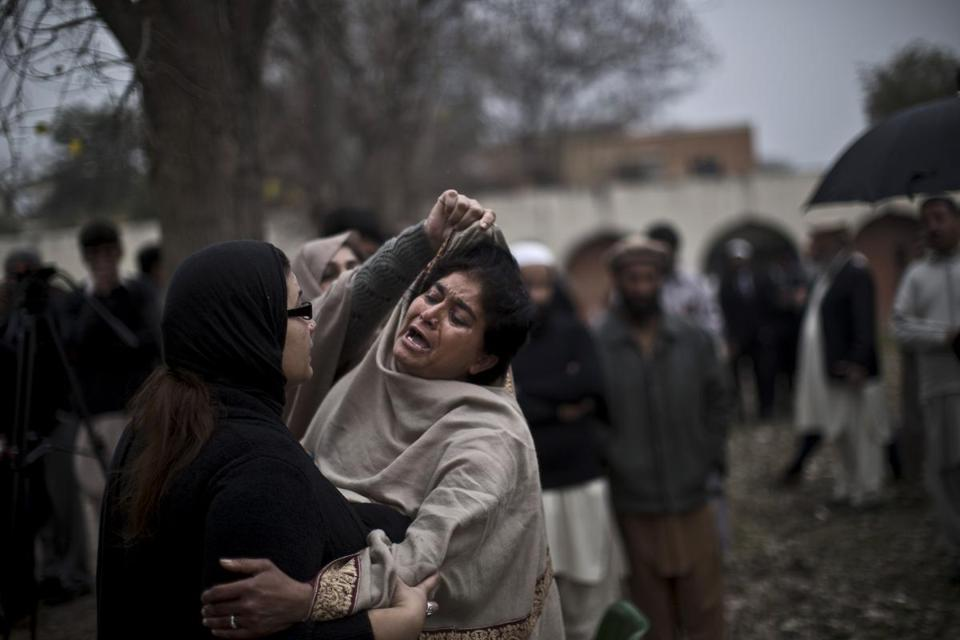 A woman was comforted Monday near a morgue in Islamabad where 								bodies of the suicide attackers' victims were taken.