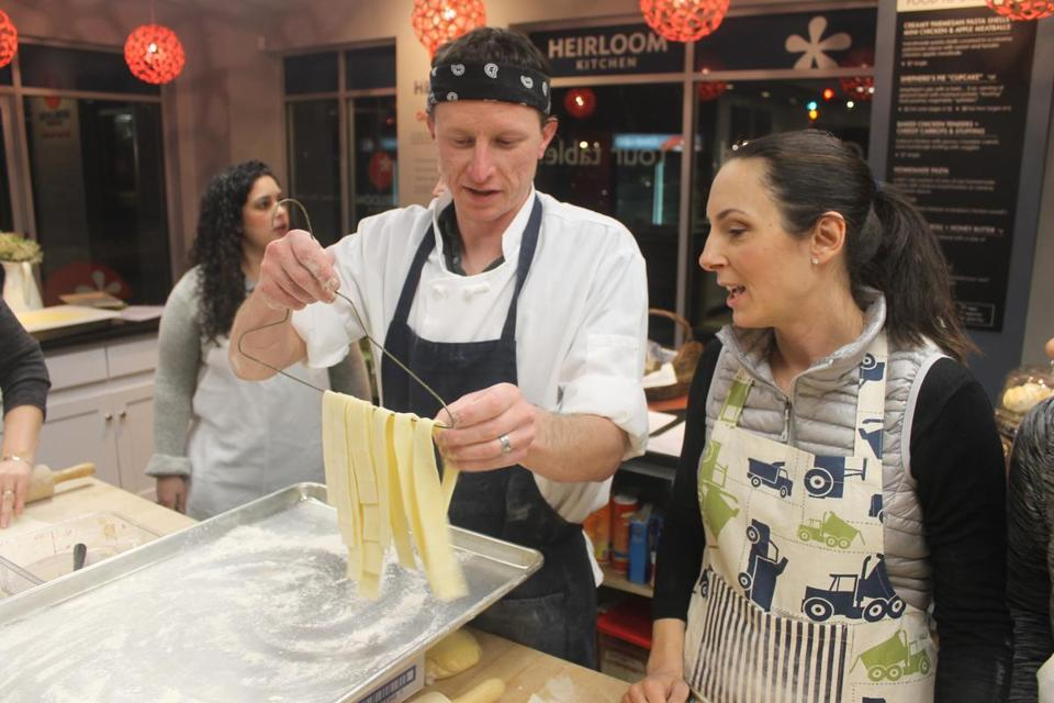Chef Ed Hoffey with student Dawn Oakes during class.