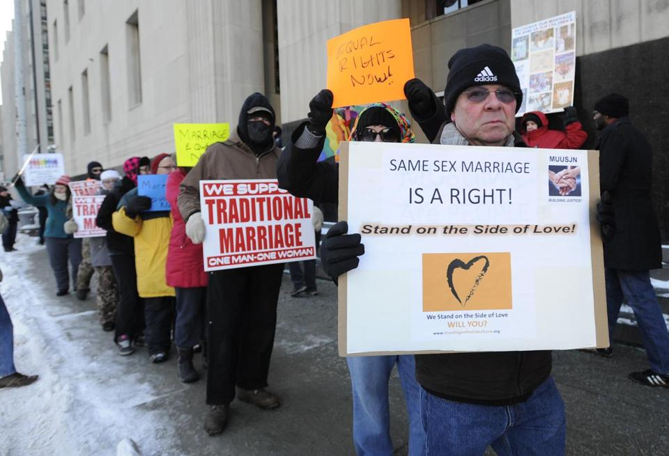 Advocates on both sides of the issue demonstrated outside the Detroit courthouse Monday.