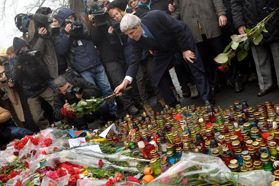 Secretary of State John F. Kerry placed flowers atamemorial to antigovernment protesters killed in Kiev last month.