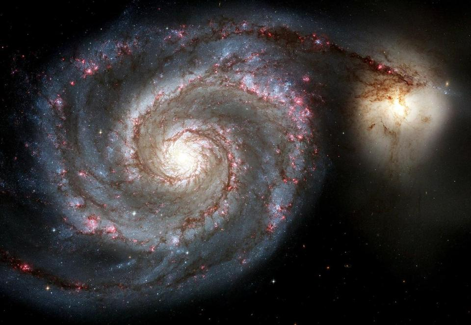 A photo of the Whirlpool Galaxy taken by the Hubble Space Telescope.