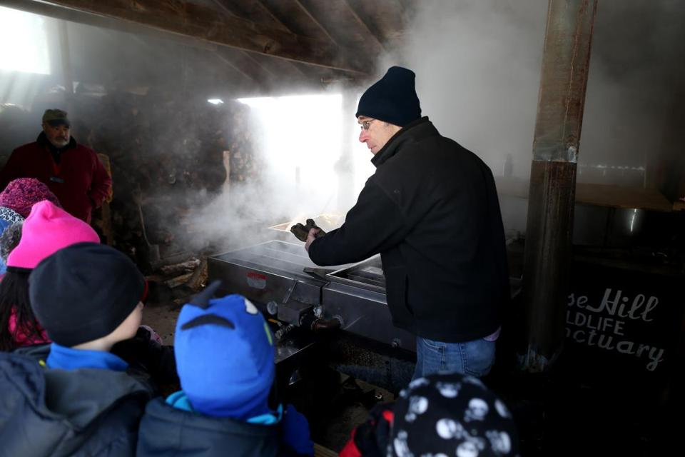 William Comery explains the maple sugaring process to students from Holliston's Sam Placentino Elementary School at the Moose Hill Wildlife Sanctuary.