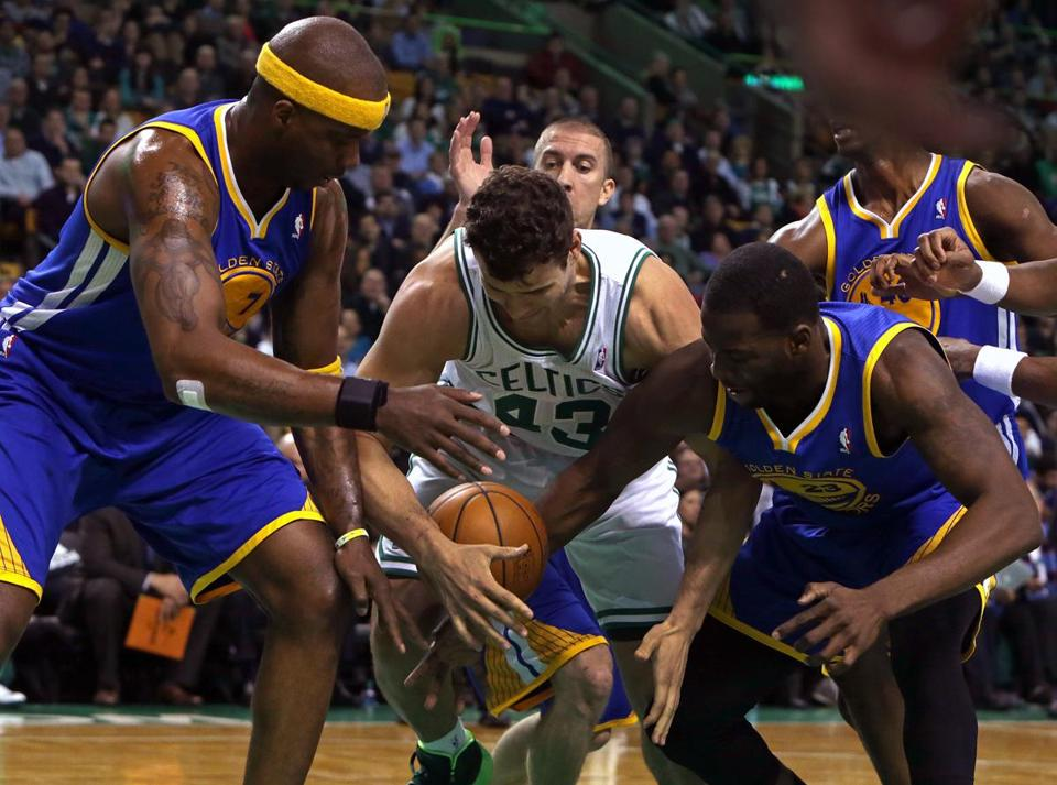 Boston Celtics center Kris Humphries (43) wass outnumbered by blue jerseys as he went after a loose ball in the first half.