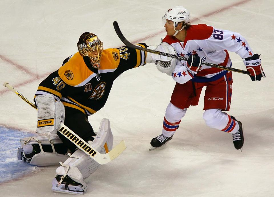 Tuukka Rask shoved Jay Beagle in the first period as the Capitals player skated by the net.