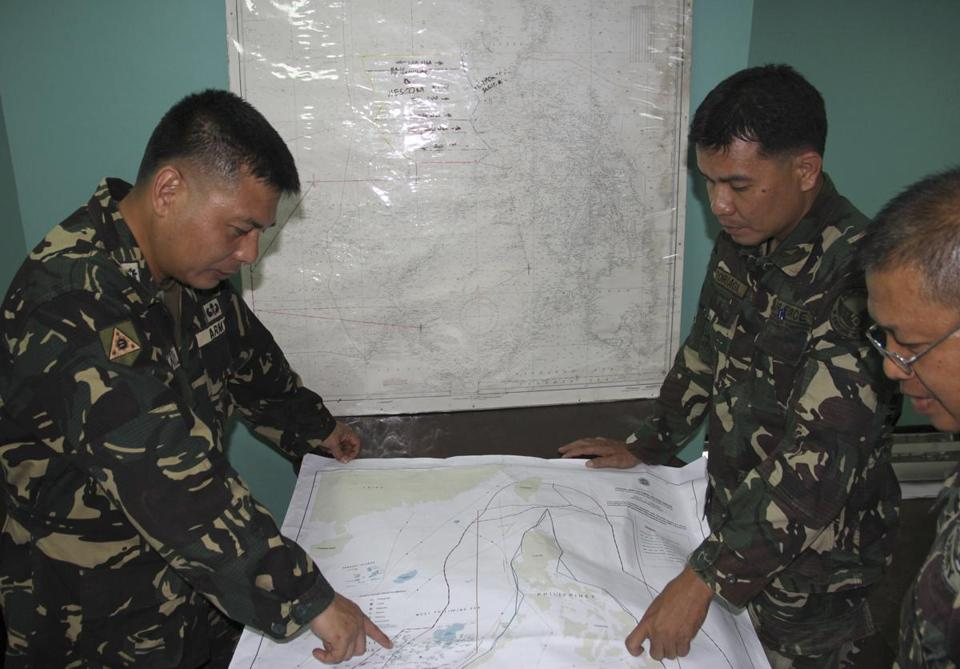 Troopers from the Philippines looked at a map as they assisted in the search for the missing Malaysia Airlines plane.