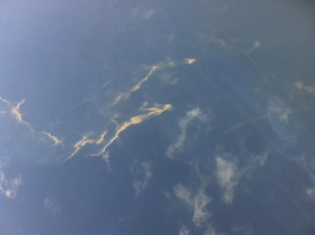 An oil spill is seen from a Vietnamese Air Force plane in the search area for the missing Malaysia Airlines Boeing 777.