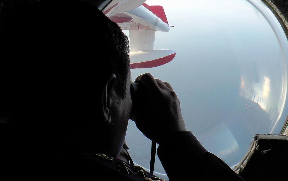 Searchers for the missing airliner scanned the waters off the northeastern coast of  Malaysia from the air.