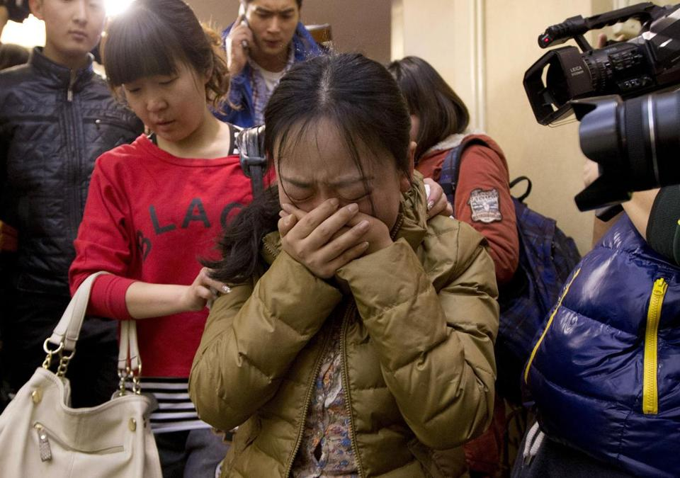 A Chinese relative of passengers aboard a missing Malaysia Airlines plane was accompanied from her hotel room in Beijing on Sunday.  From North America to Australia and China, families and friends were enduring an agonizing wait for news about the fate of the plane.