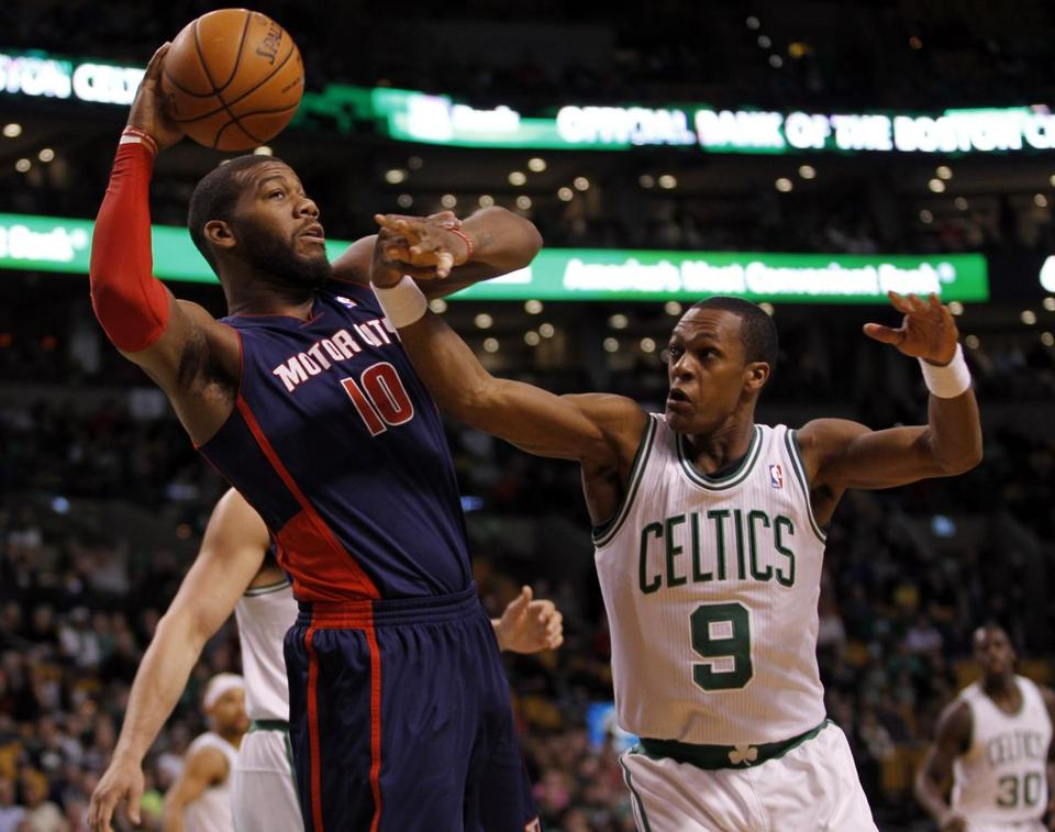Rajon Rondo battled for a rebound with the Pistons' Greg Monroe in the first quarter.
