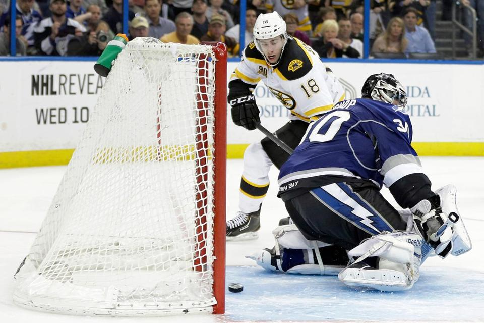 Reilly Smith slips a pretty goal by Ben Bishop to win it for the Bruins in the seventh round of a shootout.