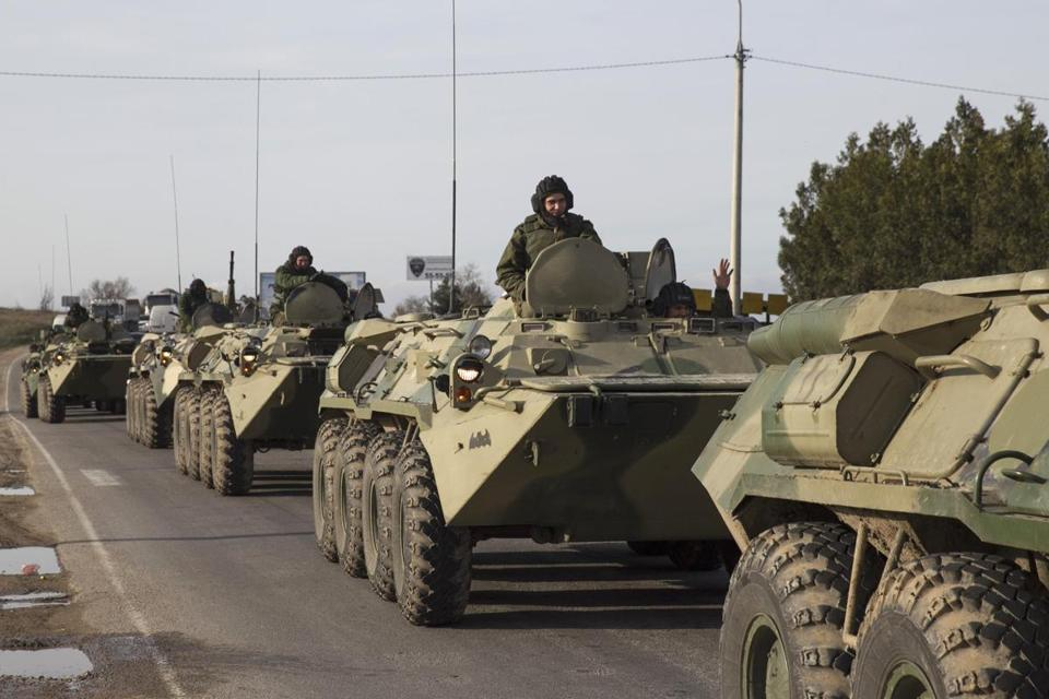Soldiers believed to be Russian rode on armored personnel carriers near Sevastopol in the Crimea Monday.