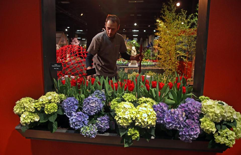 Brian O'Neill of Malden readying his exhibit at the Boston Flower & Garden Show at the Seaport World Trade Center.