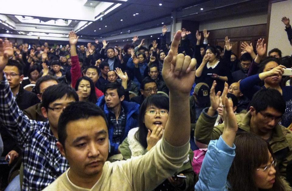 Family members of passengers aboard Flight 370 voted in Beijing Wednesday to demand answers from the airline.