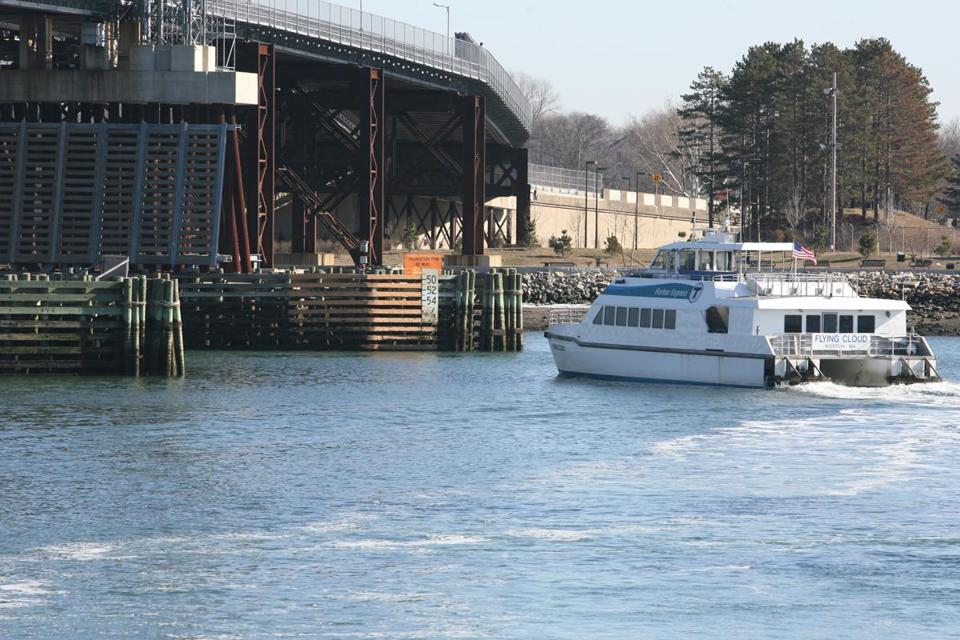 An MBTA commuter ferry leaves Quincy en route to Boston in 2008. The T says it is permanently canceling its Quincy ferry service and selling its terminal there.