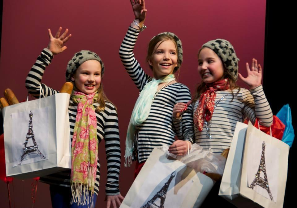FRENCH DRESSING — About 100 students from Thorpe Elementary School in Danvers modeled fashions to raise more than $6,000 to expand and renovate the school library and create a common learning and research area. Third-graders (from left) Emma Wilichoski, Maxine Lapine, and Lilly Walfield dressed with a Paris theme.