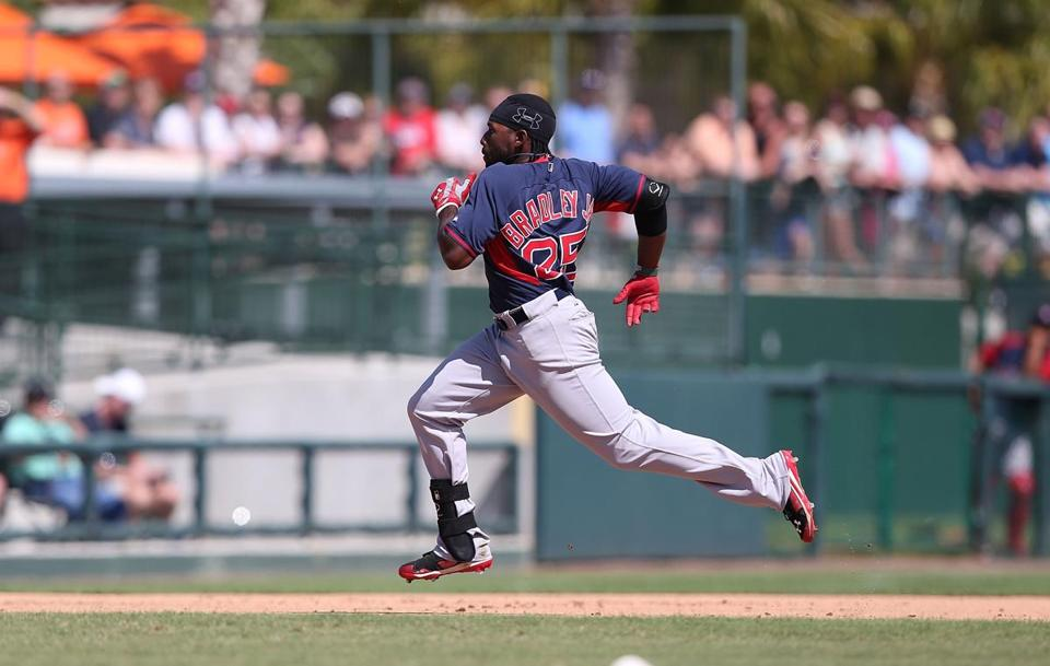 Jackie Bradley Jr. flies around the bases on a seventh-inning triple against the Orioles. (Photo by Leon Halip/Getty Images)
