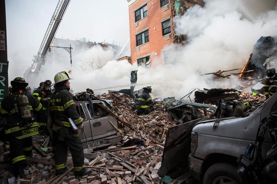 Firefighters spent most of the day dousing flames after an explosion flattened two East Harlem apartment buildings on Park Avenue on Wednesday. (Photo by Andrew Burton/Getty Images)