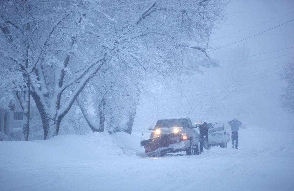 A snowplow cleared roads and driveways in Kalamazoo, Mich.