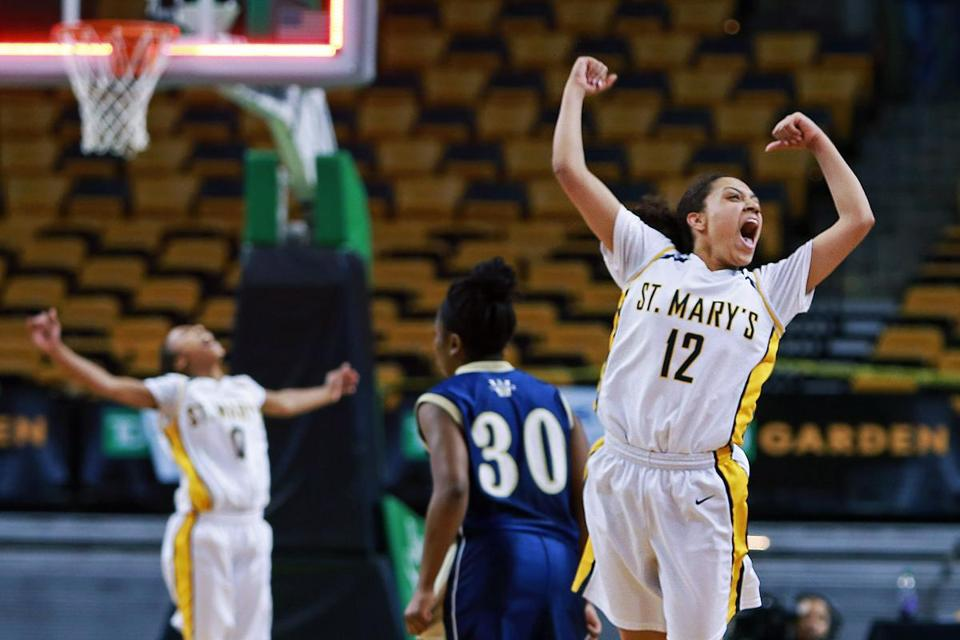 St. Mary's Brianna Rudolph, who scored a game-high 31 points, leaps for joy as the final buzzer sounds.