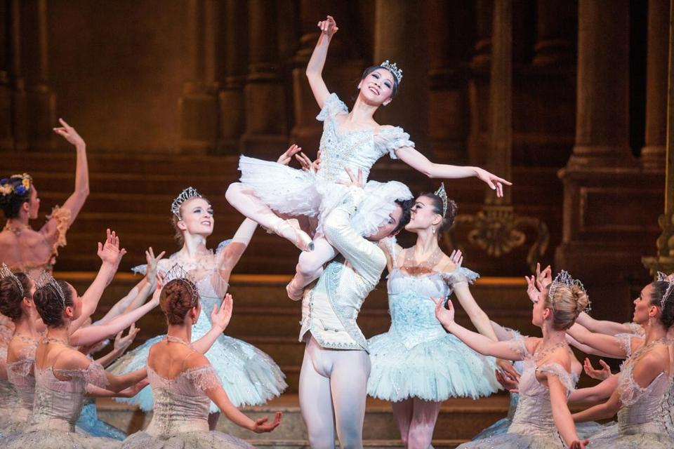 Above, Misa Kuranaga stars as Cinderella. Below, Yury Yanowsky (center left) and Boyko Dossev play her stepsisters.