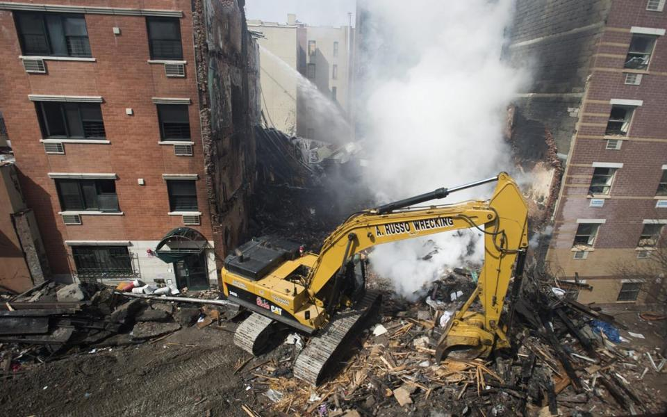 Fires burned at the site Thursday where two buildings were destroyed in a blast Wednesday.