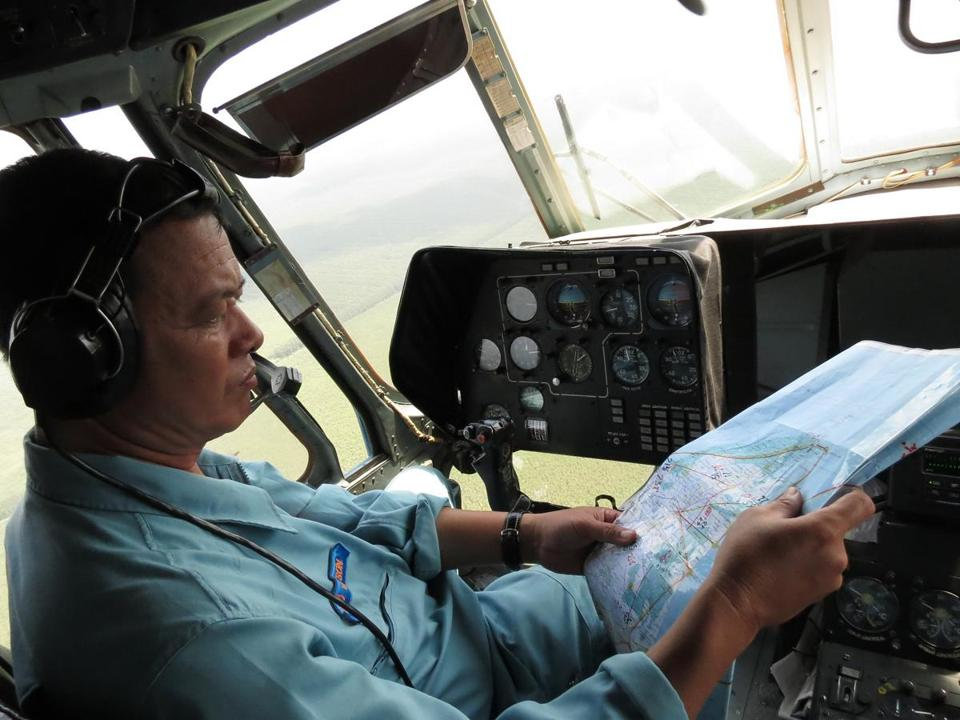 A crew member aboard a Vietnam Air Force Mi-17 helicopter looked at a map during a search operation for the missing Malaysia Airlines Boeing 777.