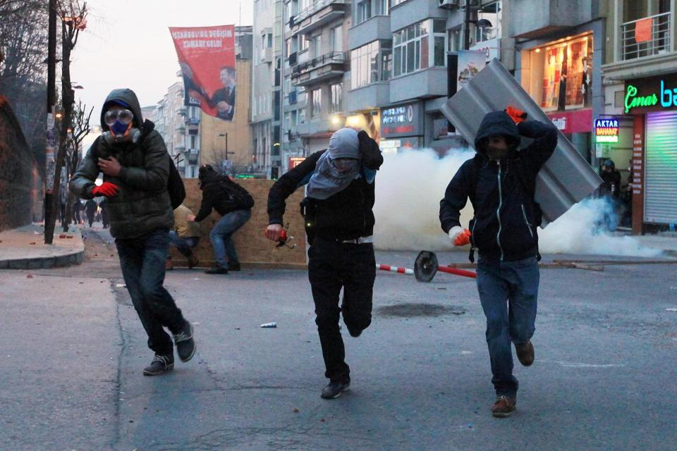 Protestors fled tear gas during clashes with riot police after the funeral of Berkin Elvan.