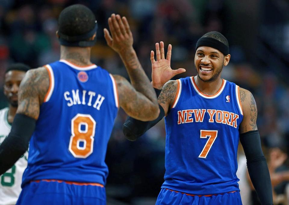 Carmelo Anthony smiled as he high-fived teammate J.R. Smith in the first half.