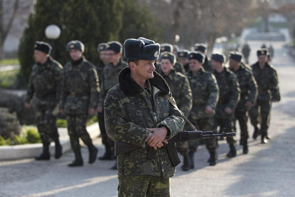 Ukrainian servicemen are pictured at the entrance to a base in the village of Lyubimovka, near Sevastopol, on Saturday.