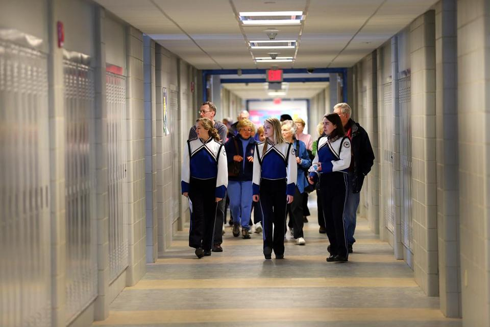 Students led a tour of first-floor classroom at the dedication of the newly renovated Danvers High School.
