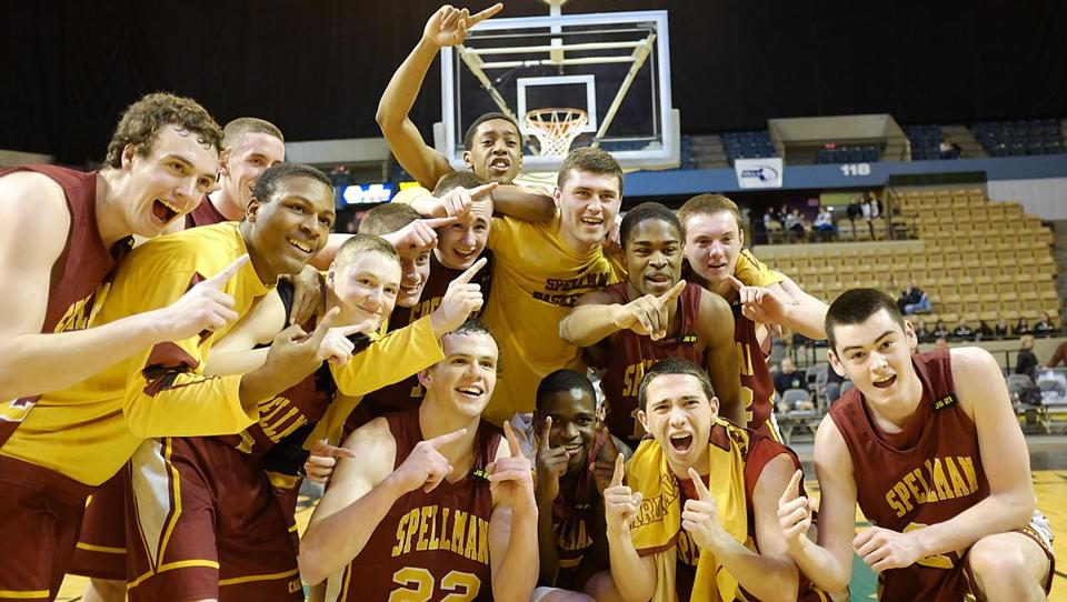 Cardinal Spellman players raise their fingers to show they are No. 1 after winning the Division 3 boys' state final.
