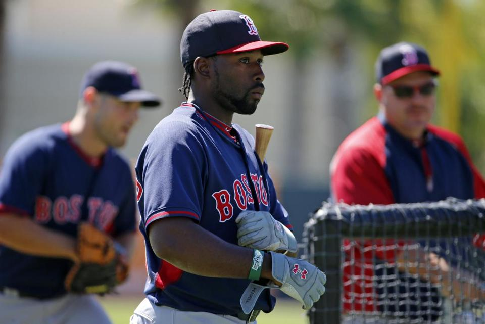 Boston Red Sox's Jackie Bradley Jr., center, waits his turn in the batting cage before an exhibition spring training baseball game against the Baltimore Orioles in Sarasota, Fla.,Saturday, March 8, 2014. (AP Photo/Gene J. Puskar)