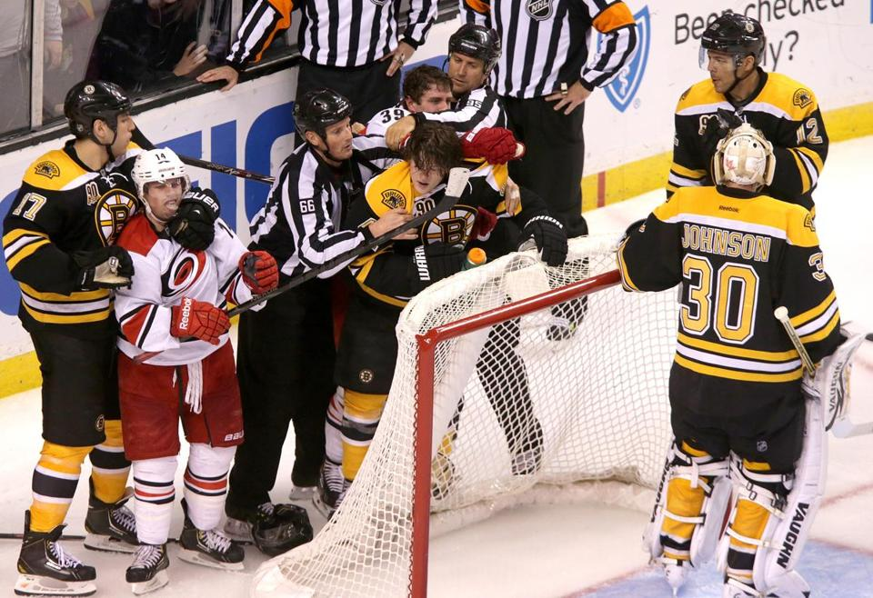 Torey Krug (center) was one of the Bruins who took issue with a hit on Johnny Boychuk.