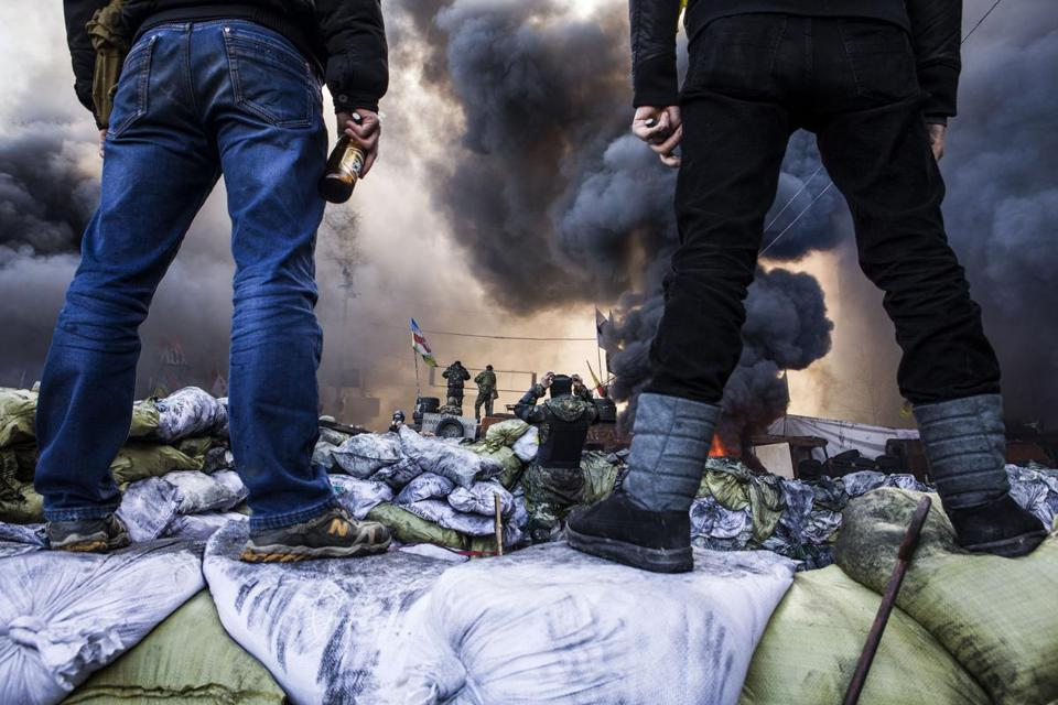 Demonstrators stood on barricades during clashes Feb. 18 with riot police in Kiev.
