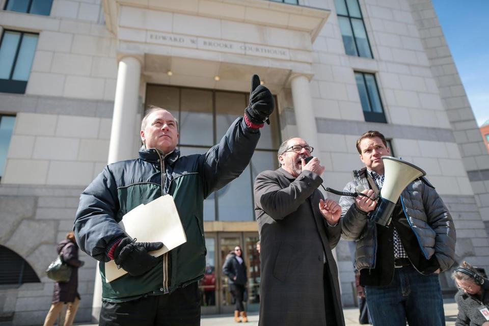 Lou Pelletier (left), Justina Pelletier's  father, signaled to protesters supporting his right to the custody of his daughter outside the Edward W. Brooke Courthouse  in Boston.