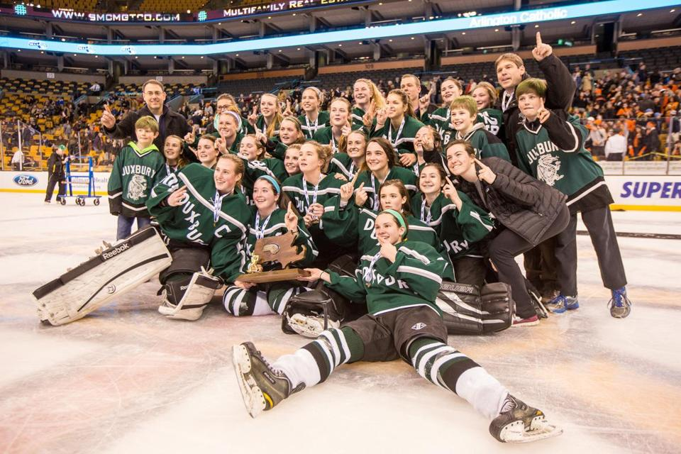 Duxbury players celebrated after winning a state title.