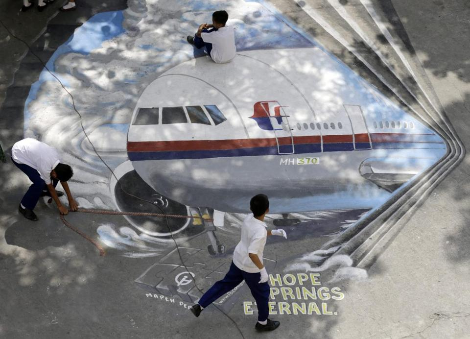 Filipino students were seen on a painting of Malaysia Airlines Flight MH370 at a high school in Manila, Philippines.
