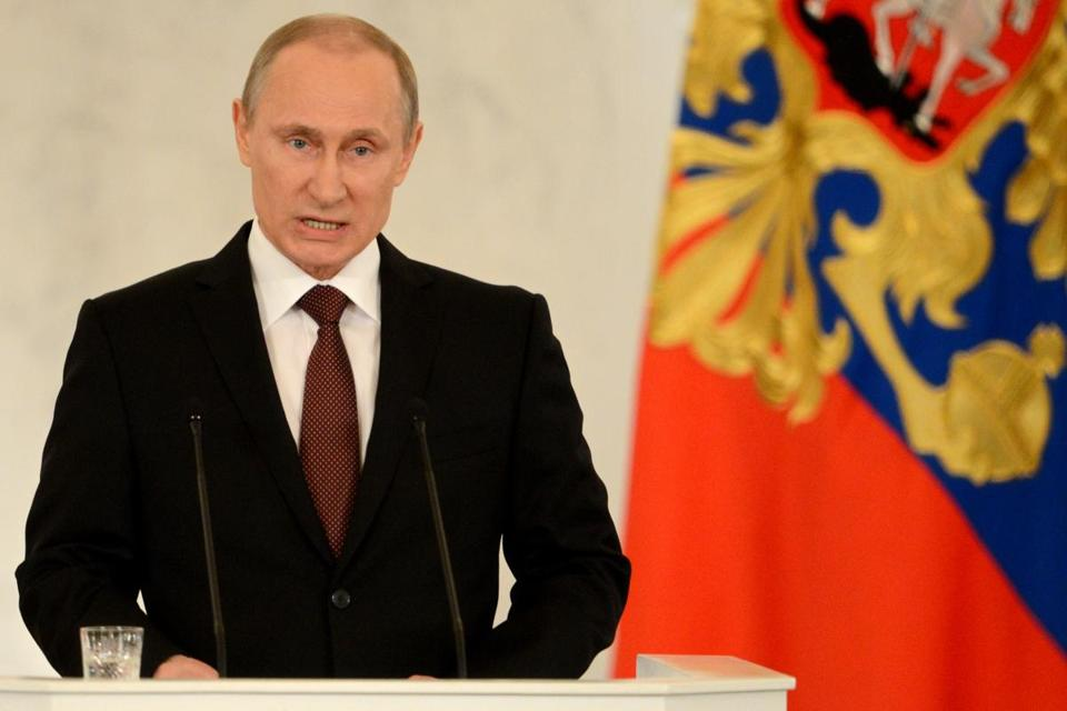 Russia's President Vladimir Putin addresses a joint session of Russian parliament on Crimea in the Kremlin in Moscow.
