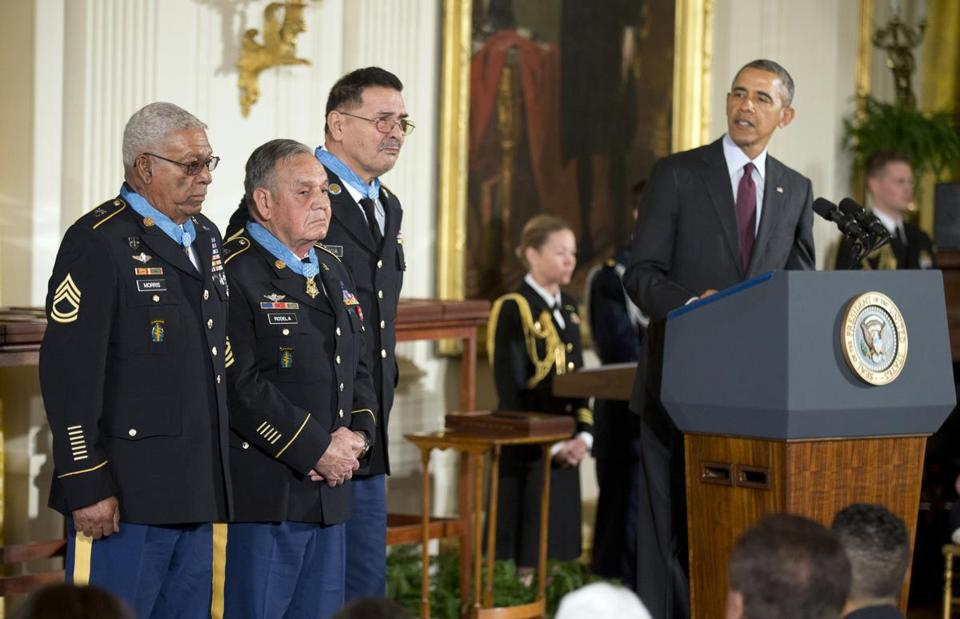 President Obama awarded the Medal of Honor to 24 recipients, including three living awardees. They are, from left, Army Staff Sgt. Melvin Morris, Army Sgt. 1st Class Jose Rodela, and Army Spc. Santiago Erevia.