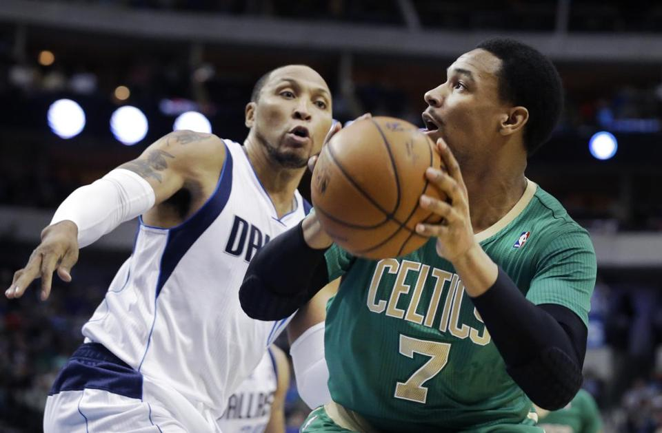 Boston Celtics center Jared Sullinger (7) is defended by Dallas Mavericks forward Shawn Marion (0) during the first half an NBA basketball game Monday, March 17, 2014, in Dallas. (AP Photo/LM Otero)