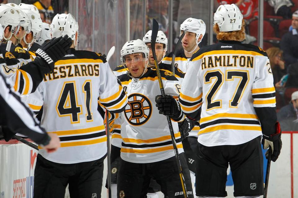 Brad Marchand celebrated his second-period short-handed goal against the Devils.