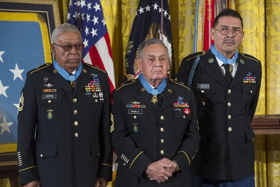 Vietnam veterans (from left) Staff Sergeant Melvin Morris, Sergeant First Class Jose Rodela, and Specialist Santiago Erevia after receiving the Medal of Honor.