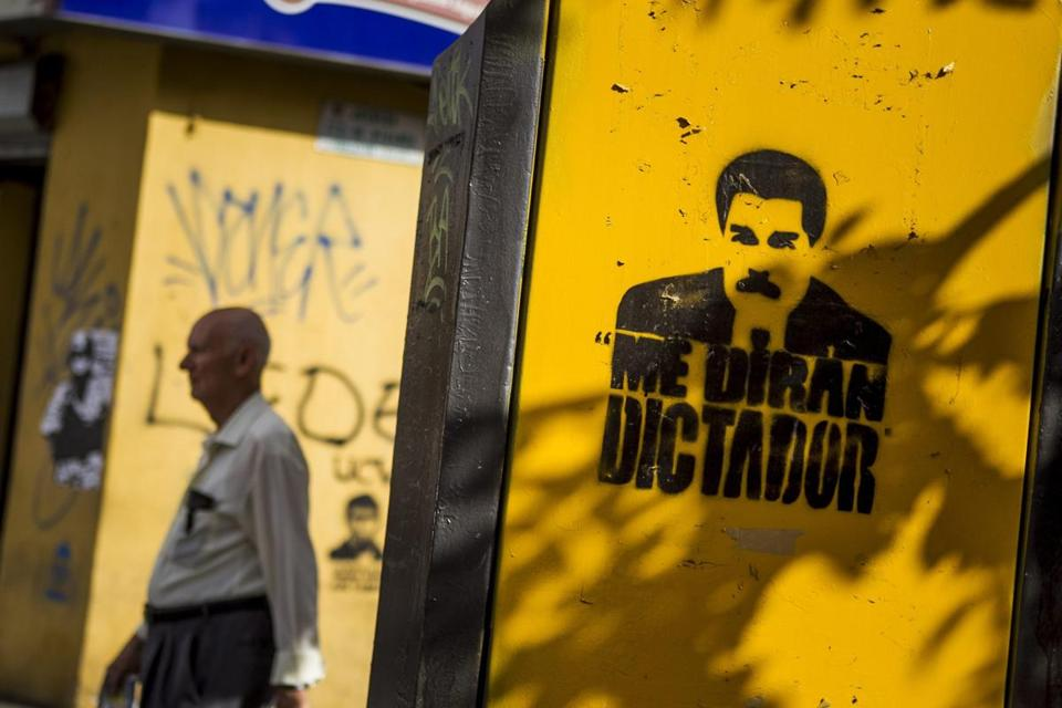 "View of a graffiti with the image of President Nicolas Maduro and a message that reads ""They will call me dictator,"" painted on a wall in Caracas, Venezuela."