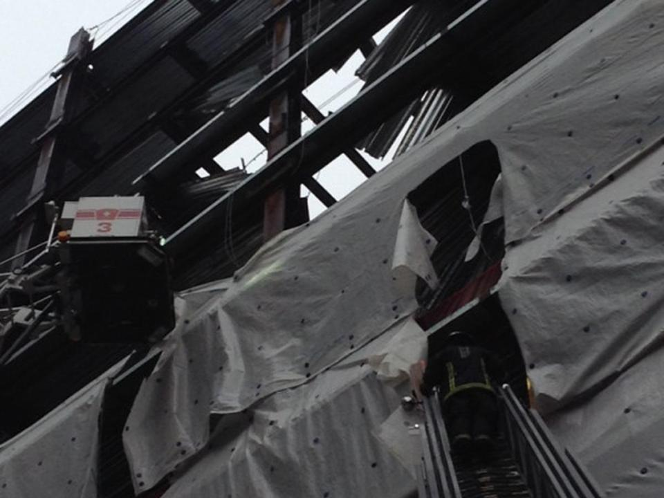 "Fire officials said at the scene, which is on the edge of the Chinatown district, that a ""dead load"" fell from the 12th floor, the highest level the project had reached so far, to the fifth floor."