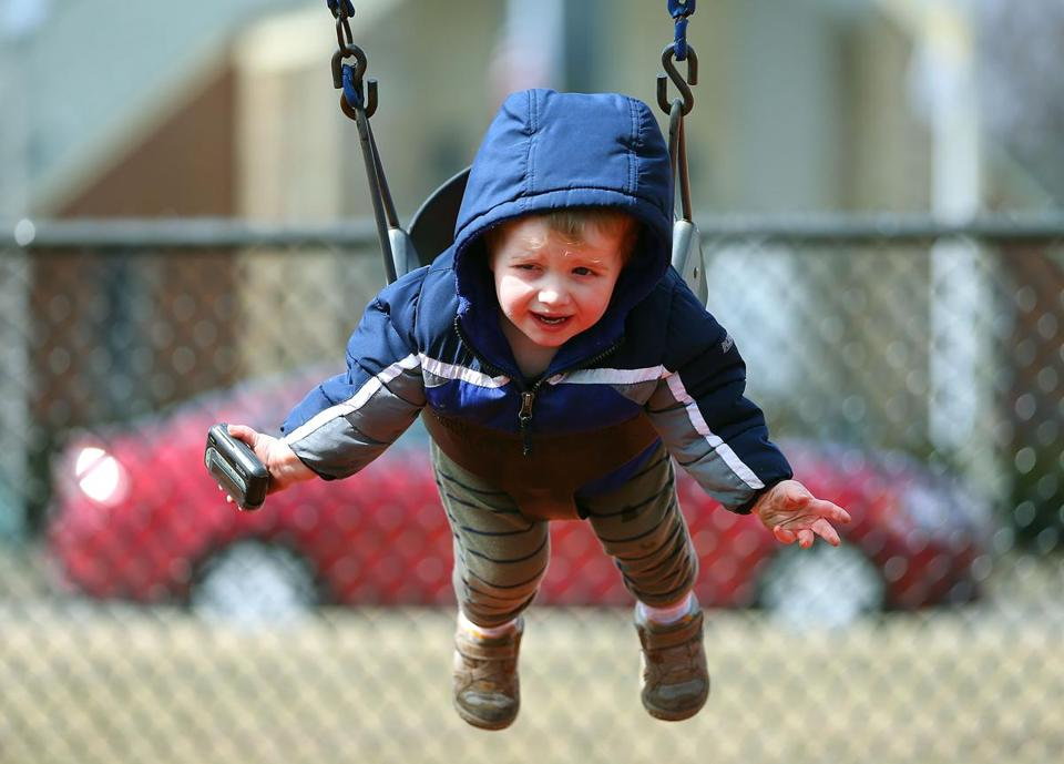 On the first day of spring, the Joe Moakley Park was empty except for Brady Laine of South Boston who got a push on a swing from his mother.