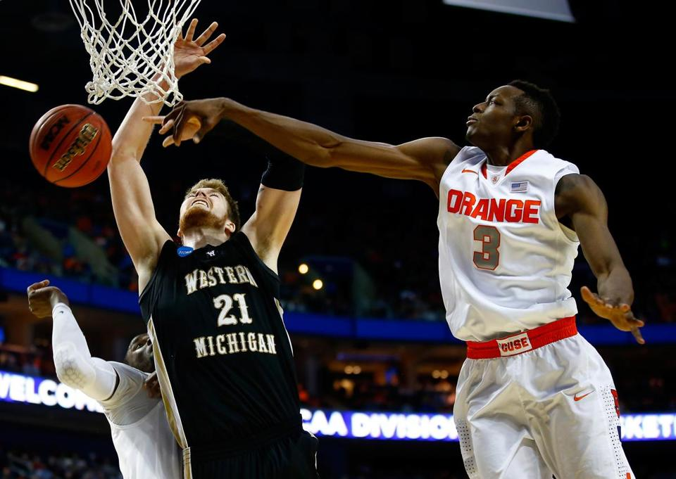 Syracuse's Jerami Grant blocks a shot by Shayne Whittington of Western Michigan. (Photo by Jared Wickerham/Getty Images)