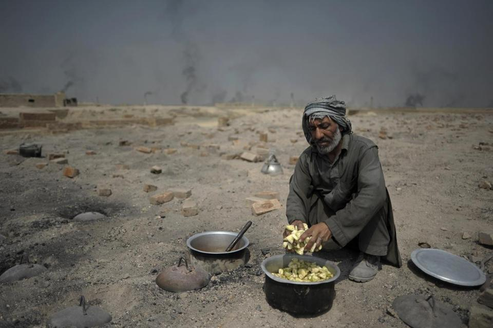 An Afghan laborer cooked a meal at a brick factory on the outskirts of Kabul in 2012.